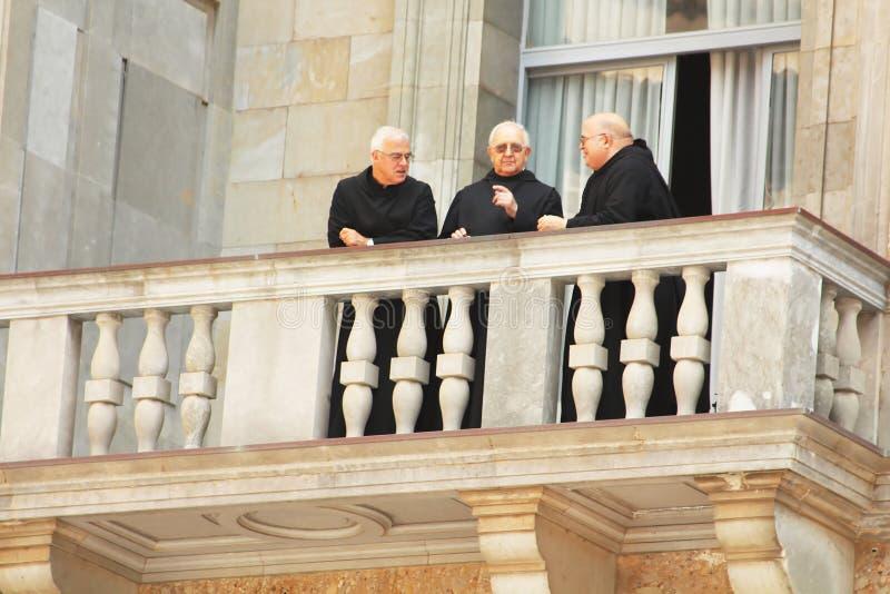 Monks are on balcony in Montserrat Benedictine monastery royalty free stock photos