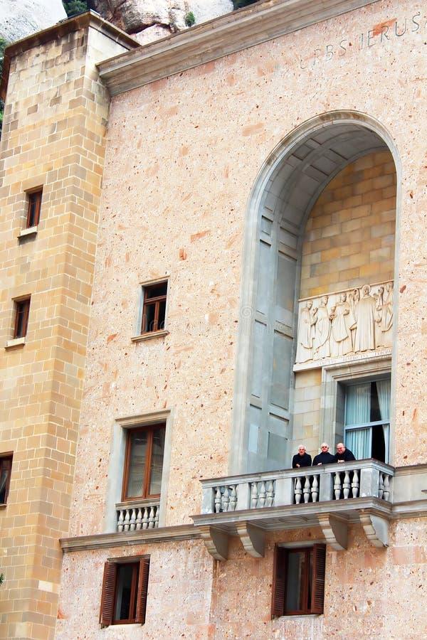 Monks are on balcony in Montserrat Benedictine monastery stock images