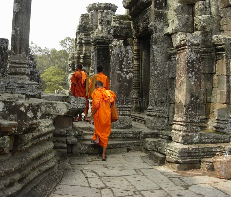 Monks at The Bayon Temple. Angkor, Cambodia stock photography