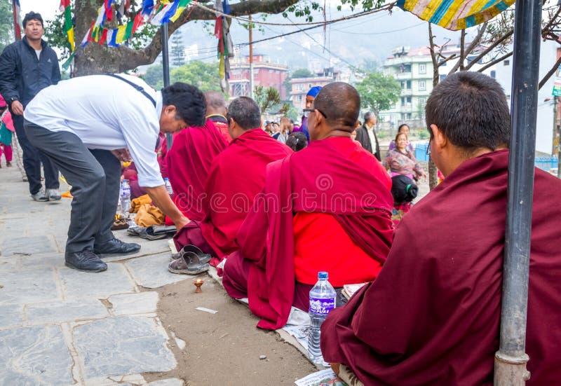 Monks begging on Buddha's Birthday. Kathmandu,Nepal - May 21,2016 : Monks are begging in Swayambhunath Stupa on Buddha's Birthday or Buddha Jayanti stock photography