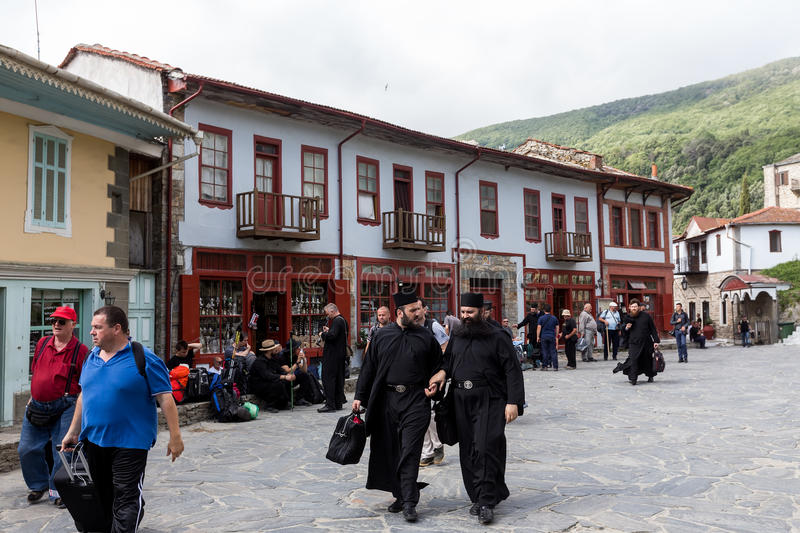 Monks and believers in Karyes Mount Athos stock photos