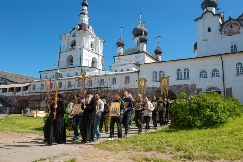 Monks and believers on the procession in the monastery. SOLOVKI, REPUBLIC OF KARELIA, RUSSIA - JUNE 27, 2018: Religious procession in the Spaso-Preobrazhensky stock image
