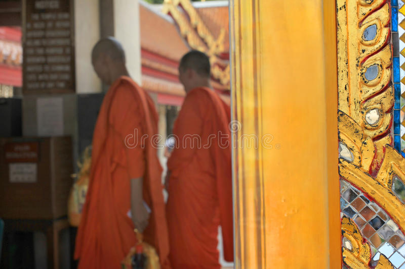 Monks of a buddhist temple in Bangkok, Thailand royalty free stock photos