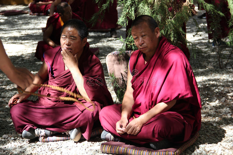 Monks debate at Sera Monastery, Tibet. Debating is part of the monastery curriculum to become a higher lama. Sera Monastery is one of the great three Gelug stock photography