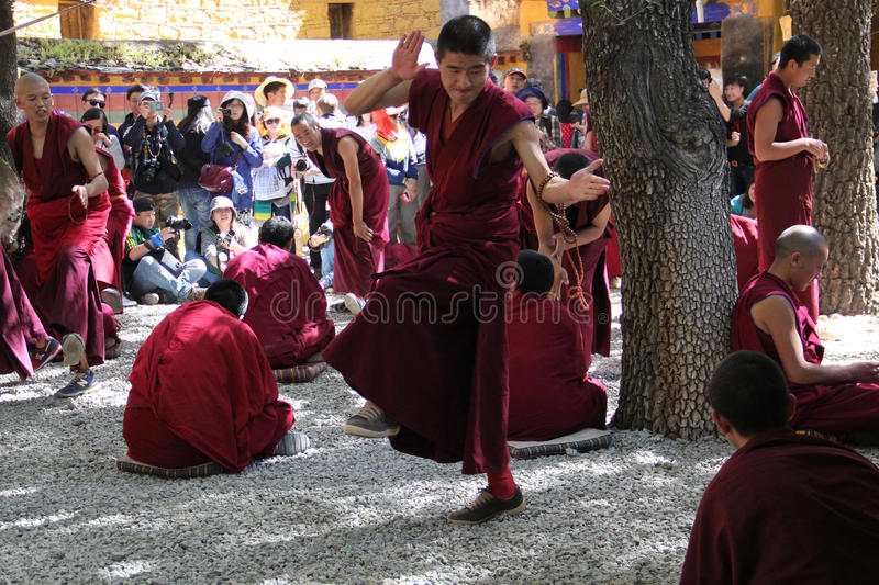 Monks debate at Sera Monastery, Tibet. Debating is part of the monastery curriculum to become a higher lama. Sera Monastery is one of the great three Gelug royalty free stock images