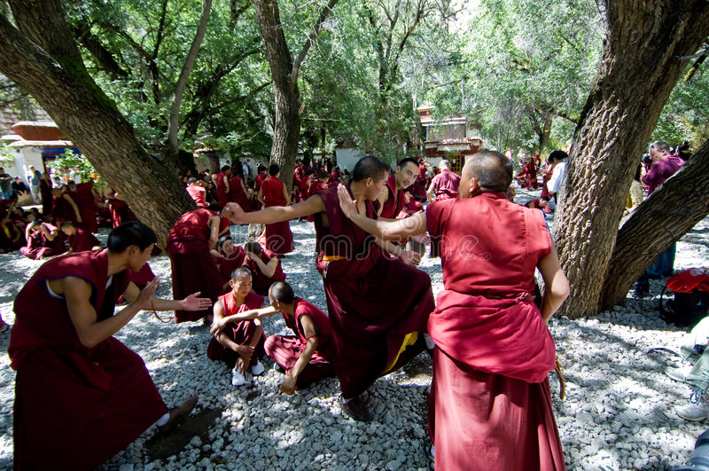 Monks Debating. Tibetan monks at Sera monastery debating in the courtyard stock photography