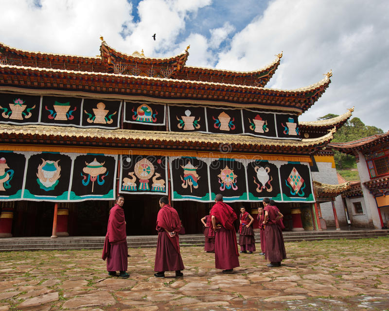 Monks debating before the monastery. The monks/Lamas are debating in front of the monastery stock images