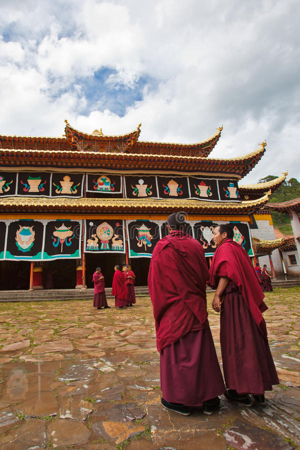 Monks debating before the monastery. The monks/Lamas are debating in front of the monastery royalty free stock images