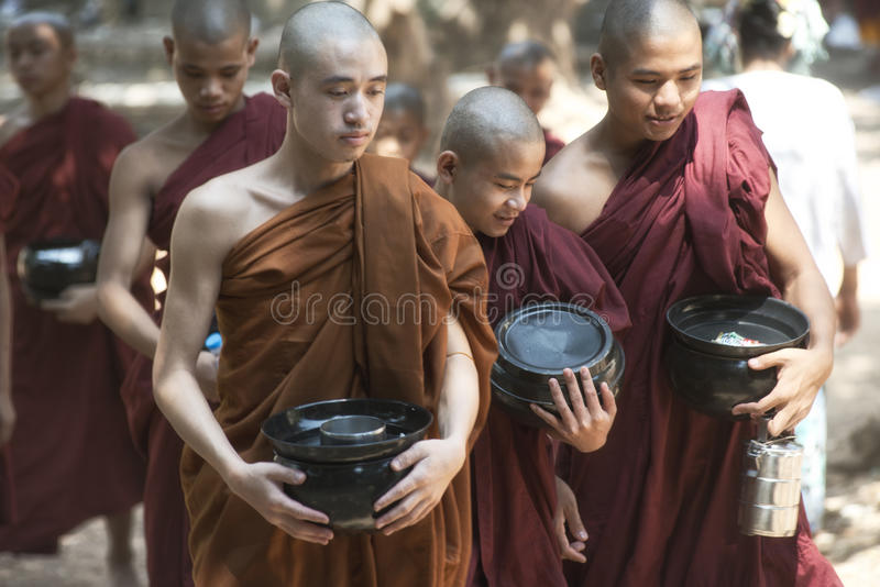 Monks Going for Lunch at Kalaywa Tawya Monastery in Yangon. stock image
