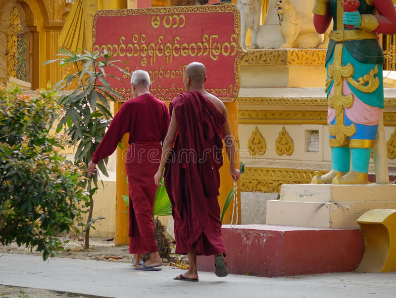 Monks at Kuthodaw pagoda in Mandalay, Myanmar stock photography