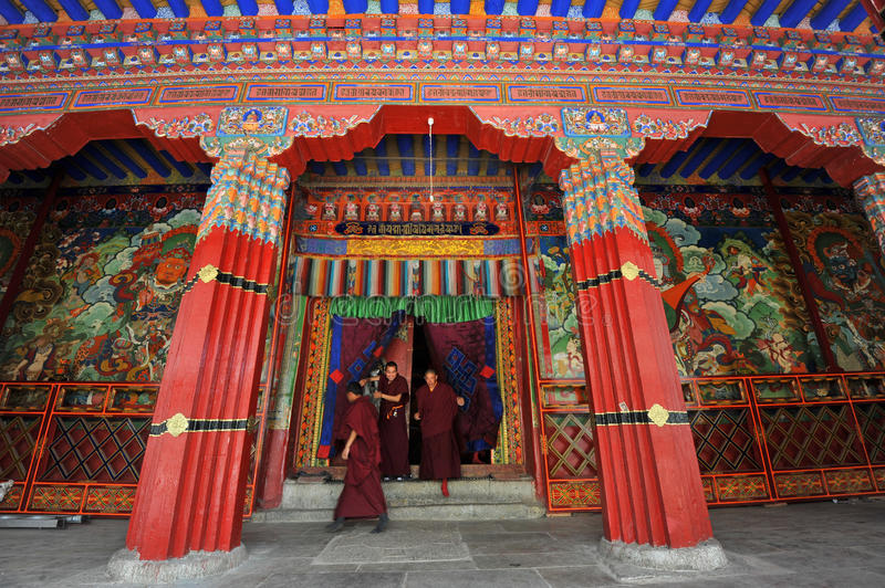 Monks leave the main college building. LHASA - MAY 3: monks leave the main college building in the Sera monastery on May 3, 2011 in Lhasa, Tibet. Those who stock photos
