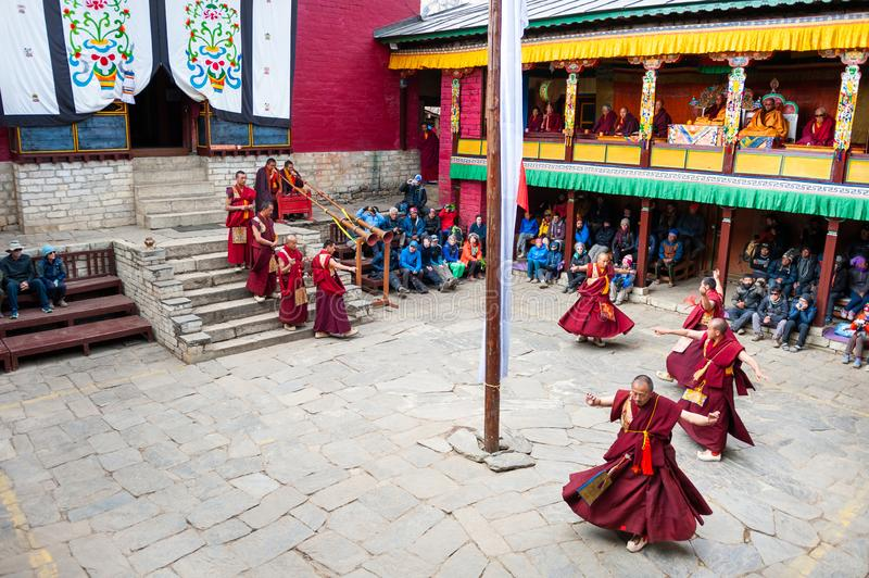 The monks perform religious buddhistic dance during the Mani Rimdu festival in Tengboche Monastery. Tengboche, Nepal - October, 24, 2018: The monks perform stock photography