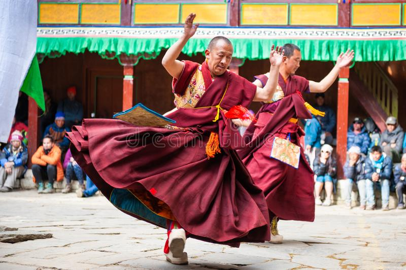 The monks perform religious buddhistic dance during the Mani Rimdu festival in Tengboche Monastery. Tengboche, Nepal - October, 24, 2018: The monks perform stock photo