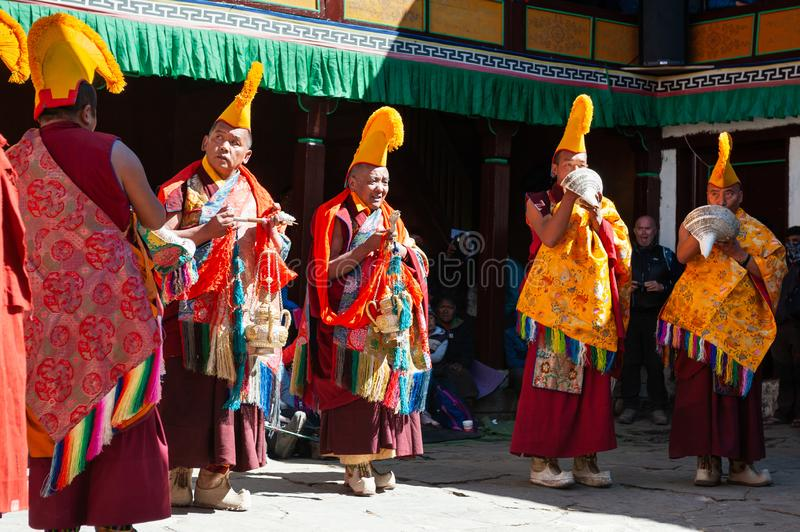 The monks perform religious buddhistic dance during the Mani Rimdu festival in Tengboche Monastery. Tengboche, Nepal - October, 26, 2018: The monks perform stock image