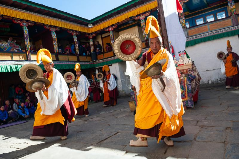 The monks perform religious buddhistic dance during the Mani Rimdu festival in Tengboche Monastery stock photography