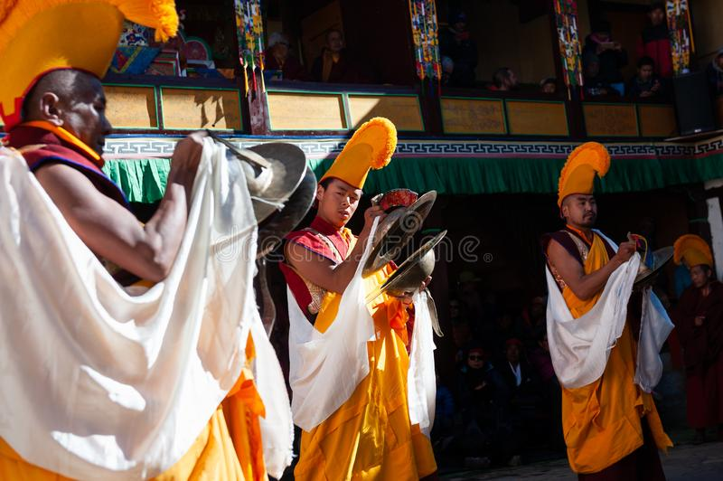 The monks perform religious buddhistic dance during the Mani Rimdu festival in Tengboche Monastery. Tengboche, Nepal - October, 26, 2018: The monks perform royalty free stock photos