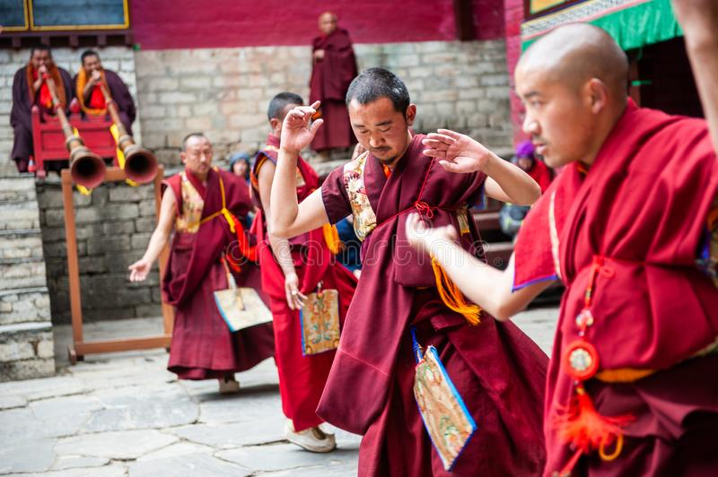 The monks perform religious buddhistic dance during the Mani Rimdu festival in Tengboche royalty free stock photos