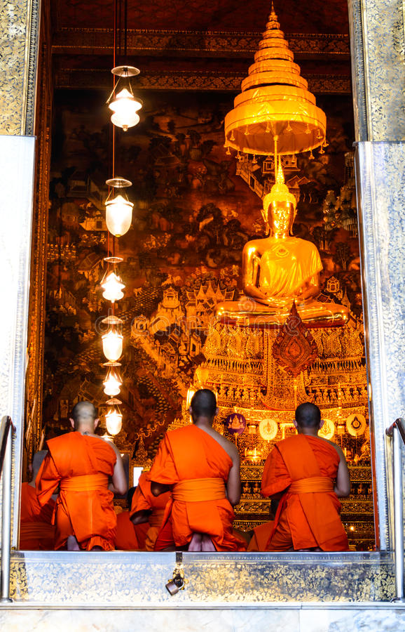 Monks pray in the evening in Wat Pho Temple.