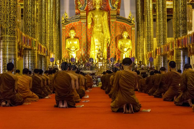 Monks praying at Wat Chedi Luang temple in Chiang Mai, Thailand royalty free stock images