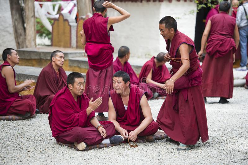 Buddhist monks` debating practice , Sera monastery , Lhasa , Tibet. Monks of Sera monastery practice the debate everyday . monks would debate the questions about stock image