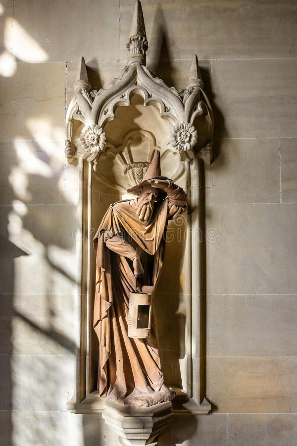 Monks statue looking like Gandalf the Wizard in Lacock Abbey, Wiltshire, UK royalty free stock images