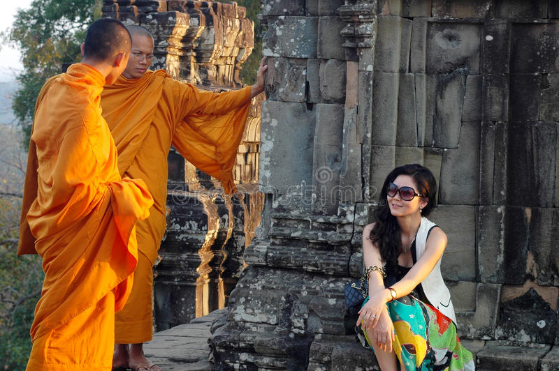 Monks and traveler in Cambodia stock photo