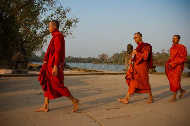 Monks walking in Angkor Wat, Siem Reap, Cambodia stock image