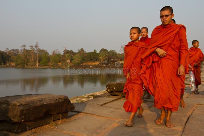 Monks walking in Angkor Wat, Siem Reap, Cambodia stock photos