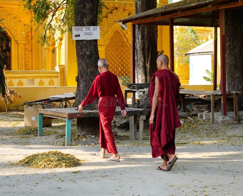 Monks walking at the pagoda in Bagan, Myanmar.  stock image