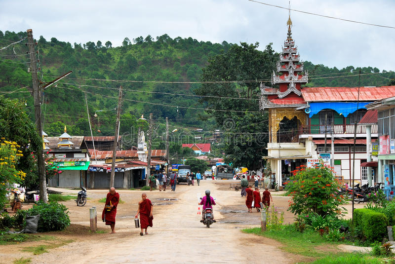 Monks walking on streets of Kalaw, Myanmar. Monks on their alms round through the streets of Kalaw, Myanmar royalty free stock photography