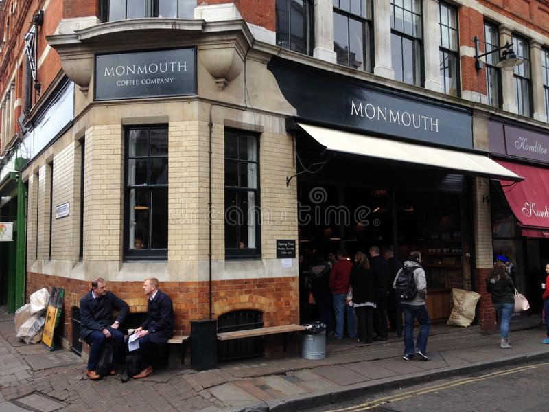 Monmouth Coffee Company. London, England - April 02, 2015: People outside and queuing to enter the Monmouth Coffee Company store near Borough Market, London. The royalty free stock image