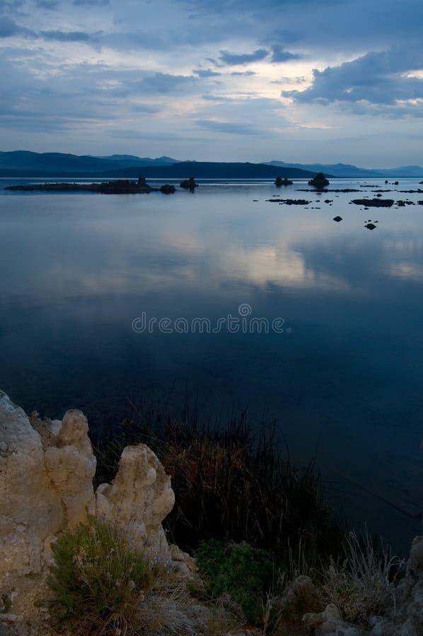 Dawn slowly lightens the morning sky bove the Tufa Reserve at Mono Lake, California. stock image