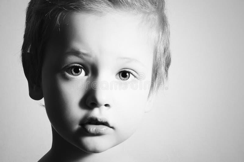 Monochrome art portrait of Child. Little Boy. Hand royalty free stock photography
