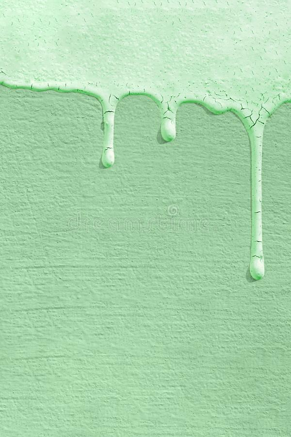 Monochrome background of the color of the trend 2020 neo mint with the texture of a concrete wall on which drops of paint froze. F royalty free stock photography