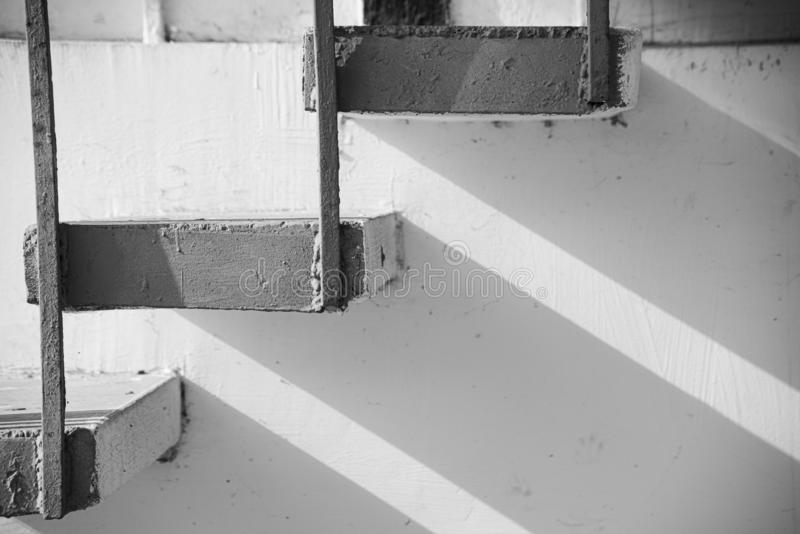 Monochrome background of stone stairs and metal construction with shadow royalty free stock photos