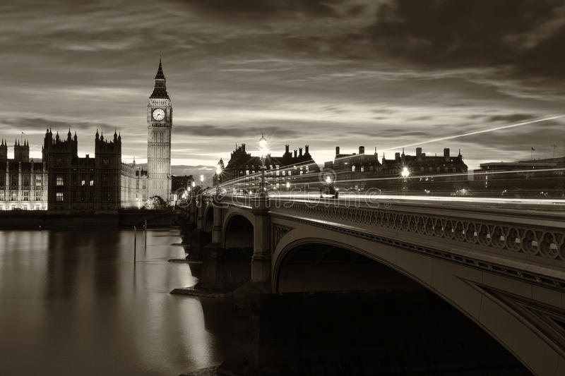 Monochrome Big Ben London. Monochrome Big Ben and London at night with the lights of the cars passing by after rain, London and England stock photo