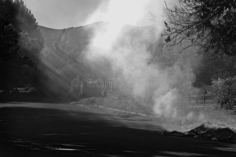 Monochrome burning garbage. Environmental pollution from acrid smoke and garbage royalty free stock photo