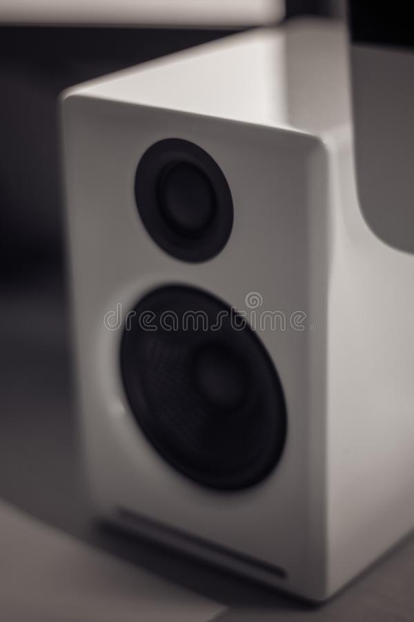 Monochrome close up of a white piano lacquer desktop speaker royalty free stock images