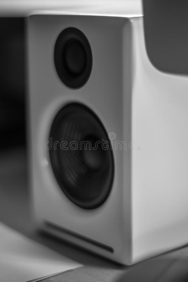 Monochrome close up of a white piano lacquer desktop speaker royalty free stock photo