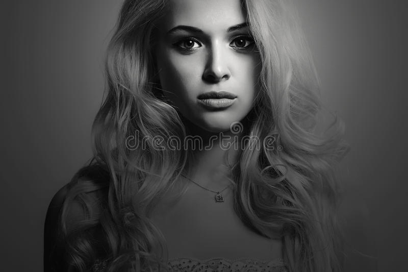 Monochrome Fashion portrait of young beautiful woman.Sexy blonde.Blond girl stock image
