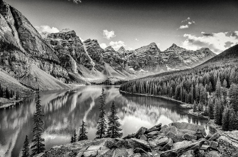 Monochrome filtered scenic view of Moraine lake, Rocky mountains royalty free stock image