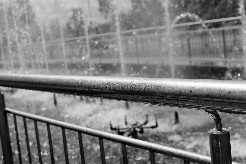 Monochrome fountain background. Fountain railing metal consuctruction. Monochrome fountain railing metal consuctruction fence background view at the side royalty free stock images