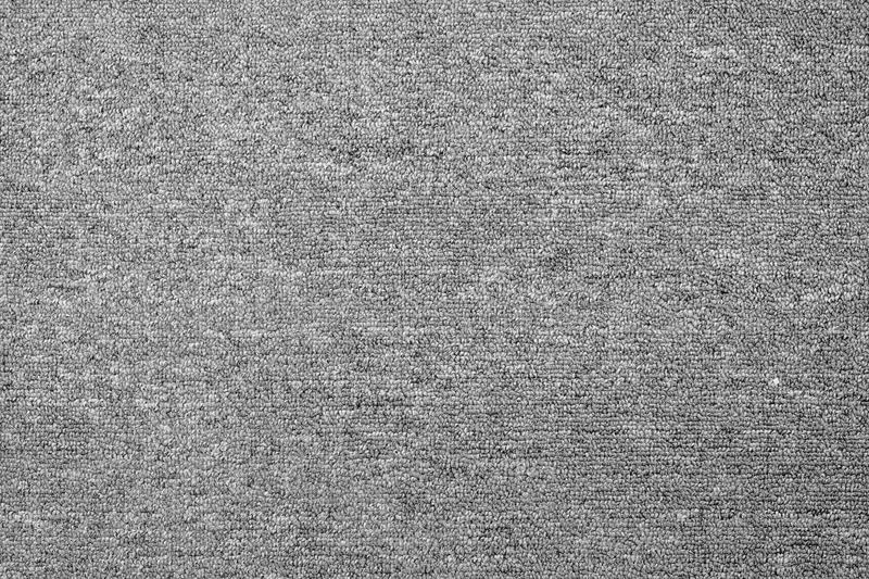 Monochrome grey carpet texture background from above. Close up of monochrome grey carpet texture background from above royalty free stock photos