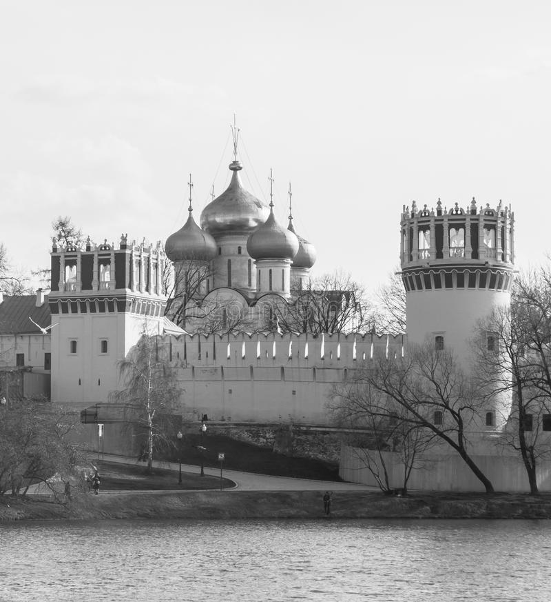 Monochrome image. Novodevichy big pond next to the ancient walls and watchtowers of Novodevichy Convent in Moscow. stock photography