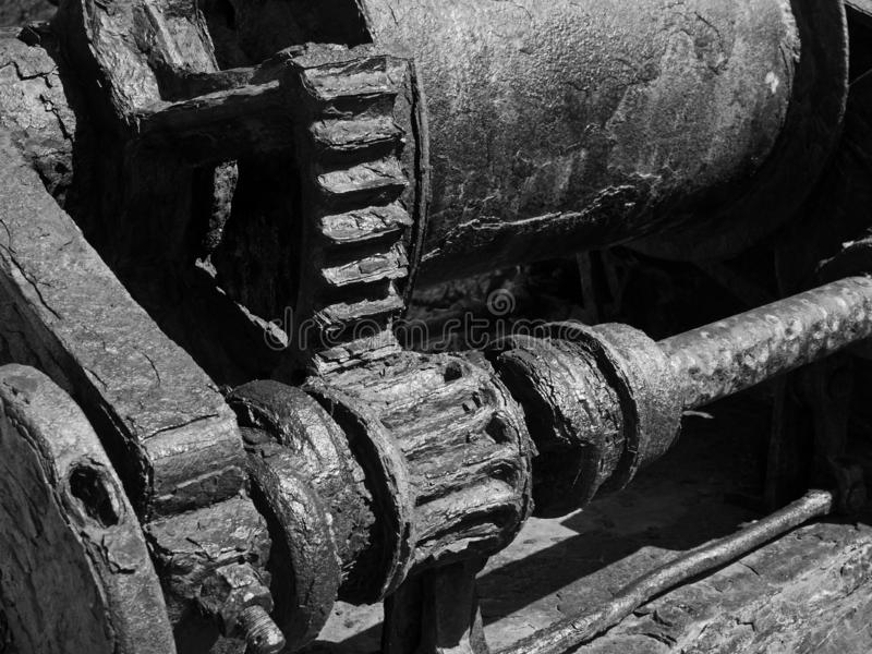Monochrome image of old rusted machinery with corroded cogs and gears. A monochrome image of old rusted machinery with corroded cogs and gears royalty free stock photo