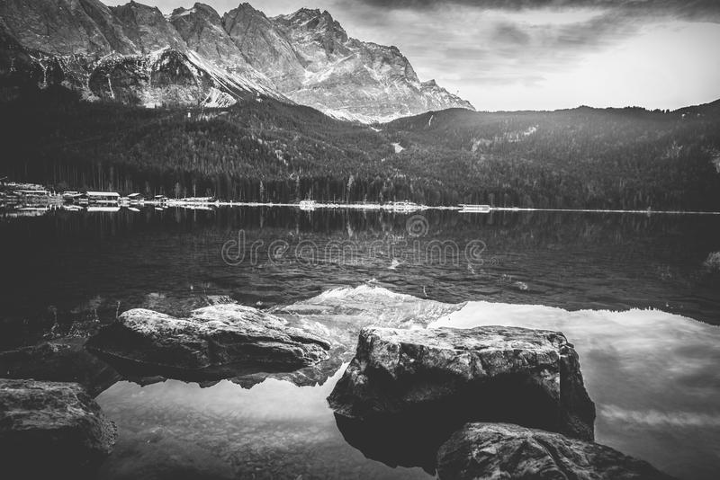 Monochrome landscape with mountains reflected in water royalty free stock image