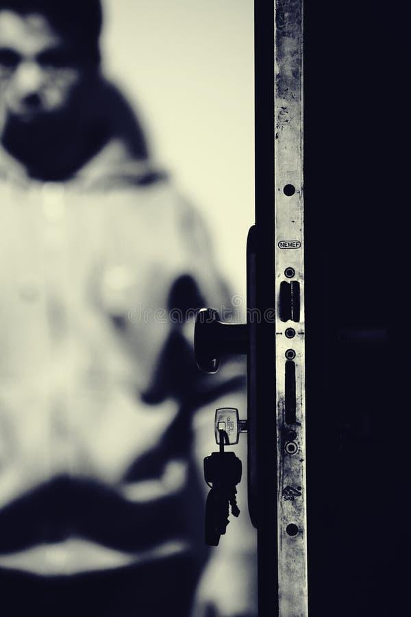 Monochrome Photo of Keys and Door Knob royalty free stock photos