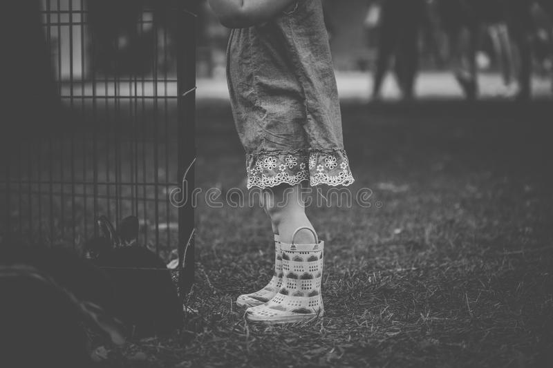 Monochrome Photography of Children Wearing Boots royalty free stock photos