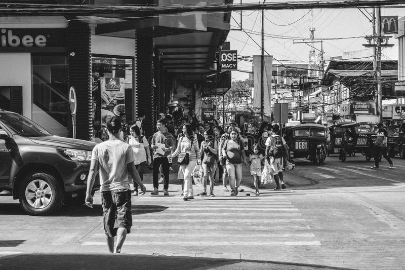 Monochrome Photography of People Crossing The Road stock image