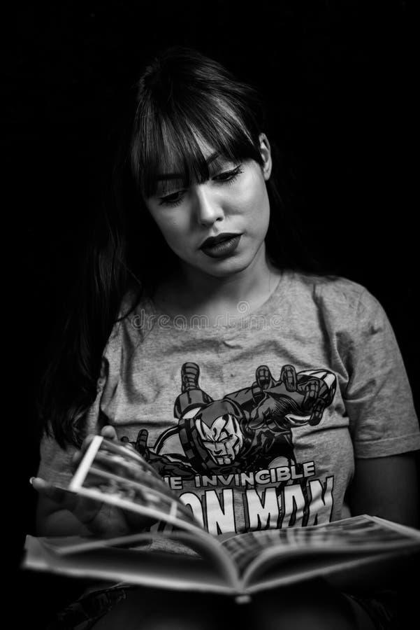 Monochrome Photography of Woman Reading Magazine stock photos